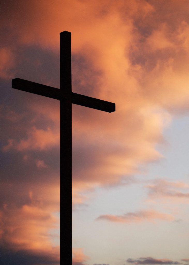 Silhouette of cross at sunrise